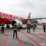Группа AirAsia возвращается к полетам после месяца простоя